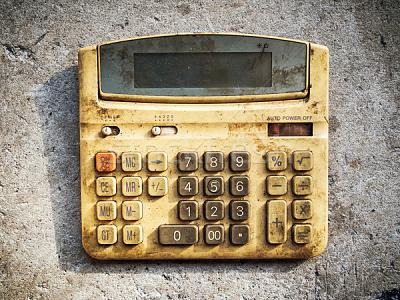 working-basel-living-france-1073968_stock-photo-dirty-old-calculator.jpg