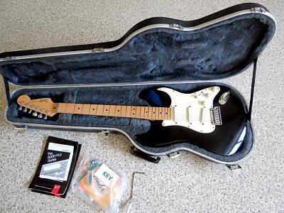 fender-stratocaster-guitar-plus-deluxe-black-made-usa-1994-wiafe61.jpg